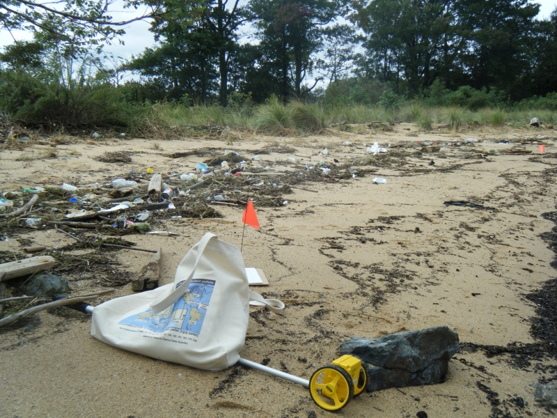 Monitoring equipment on a beach with debris.