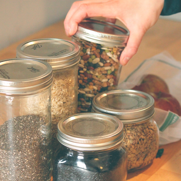 Glass jars filled with dried goods.