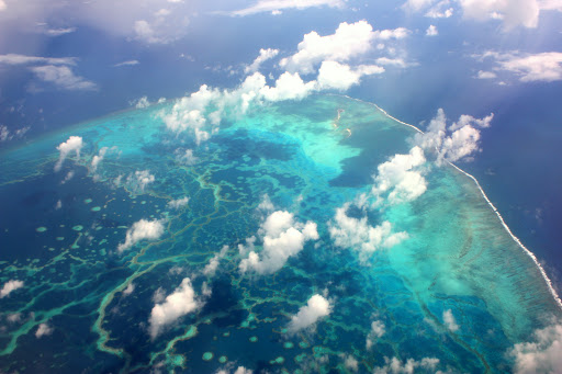 View of a coral reef from the air with clouds