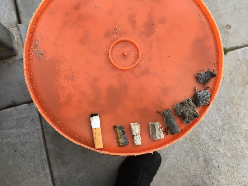 A photo of cigarette butt litter in order from newest to most degraded.