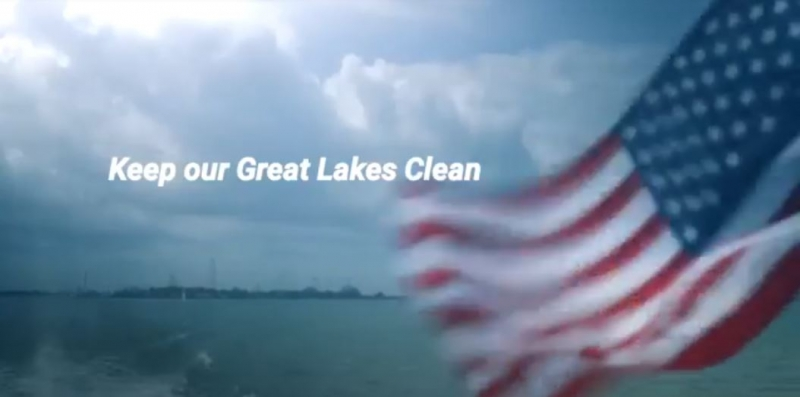 "An American Flag waves with the words ""Keep Our Great Lakes Clean"" display across the bottom of the image."