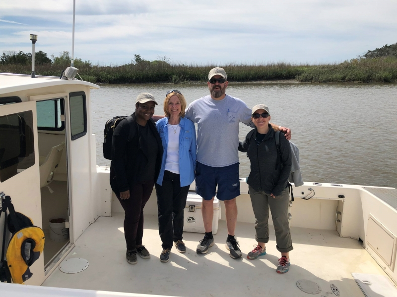 Georgia Department of Natural Resources' staff and NOAA team members on a boat.