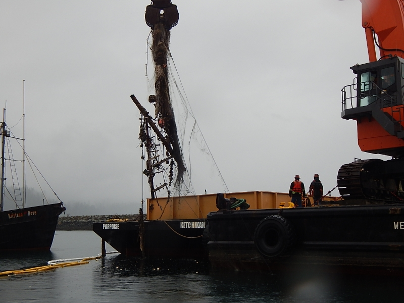 A sunken fishing vessel being removed.