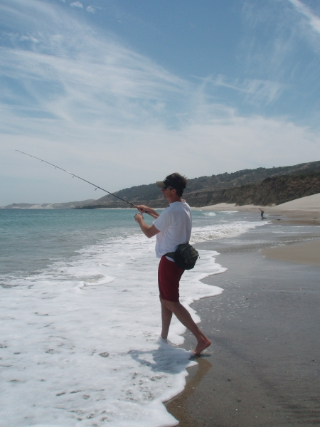 Man surf fishing.