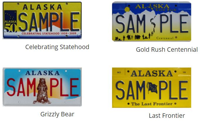 "Four license plates for the state of Alaska each say the word ""sample"" on them and have a picture that represents the state."