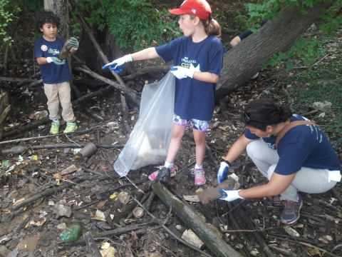 Kids cleaning up debris.