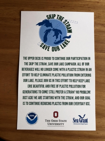 "A sign is used in restaurants to encourage guests to ""Skip the Straw and Save Our Lake""."