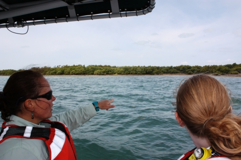 Suzy Pappas (Coastal Cleanup Corporation) and Nancy Wallace (Marine Debris Program Director) searching for marine debris on Elliot Key, Florida while on a boat.