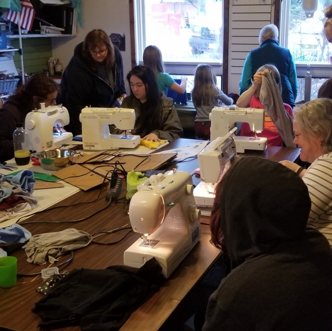 Students sew reusable bags.