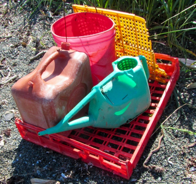 Large plastic debris including jugs and buckets.