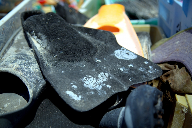 Swim fins collected by the removal team.
