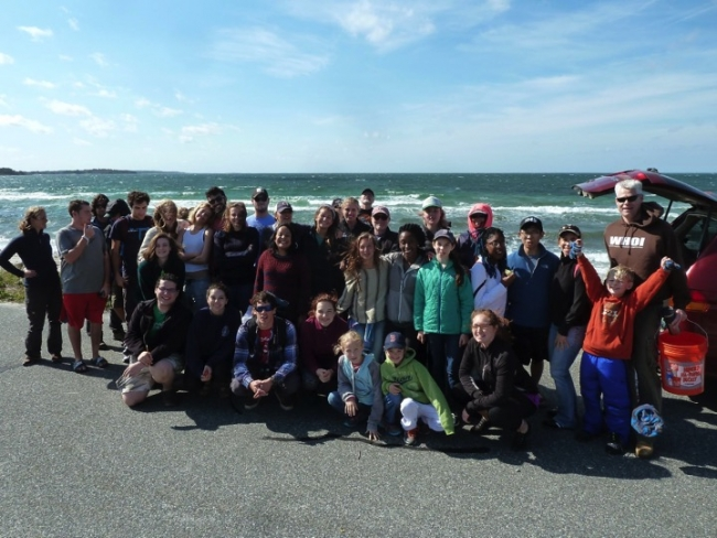 A group photo of a beach cleanup crew.