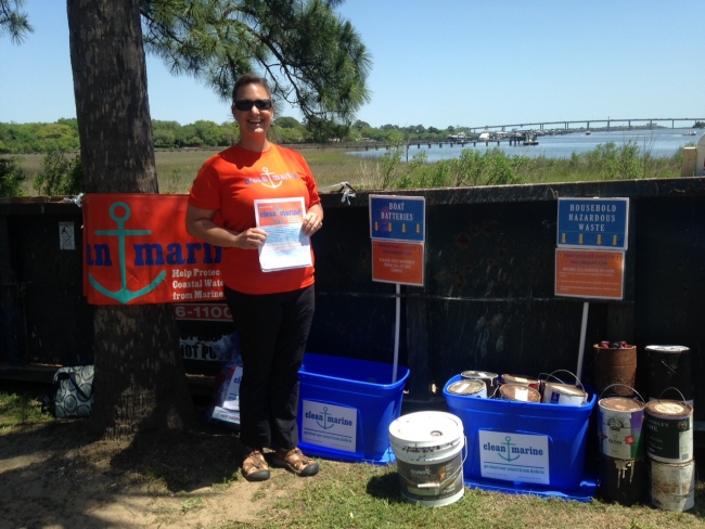 A Clean Marine volunteer helps collect items for disposal or recycling near Charleston, SC.