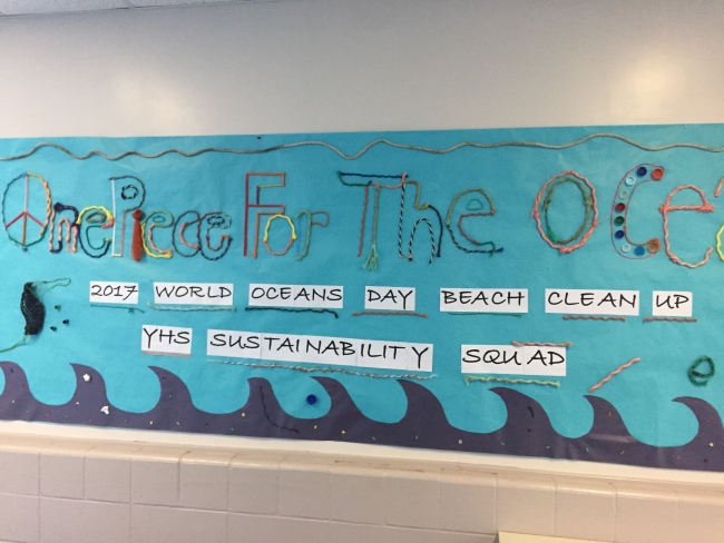 "A bulletin board sign that says ""One Piece for the Ocean."""