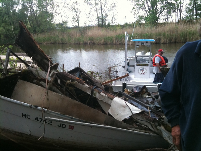 A derelict vessel that has been brought onto shore after being removed from the water.