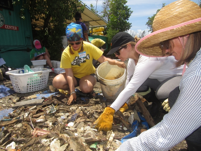 Volunteers sorting through debris.
