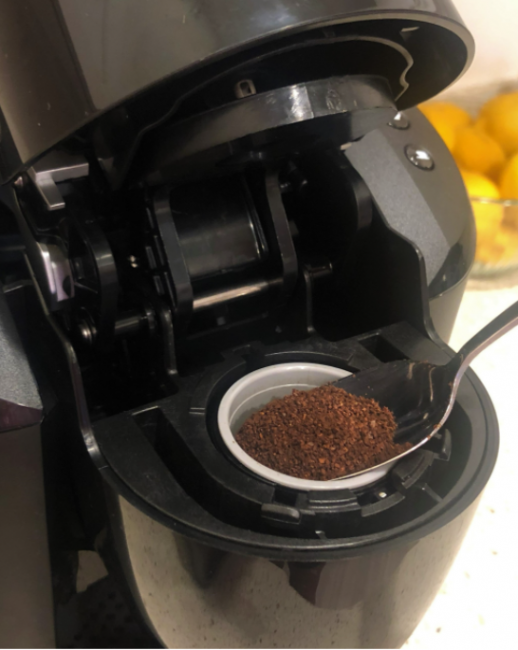 A reusable instant coffee pod being refilled.