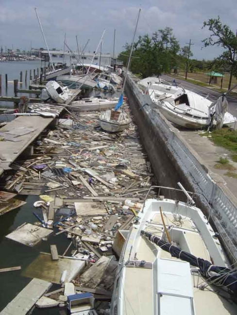 Debris and damaged vessels at a marina.
