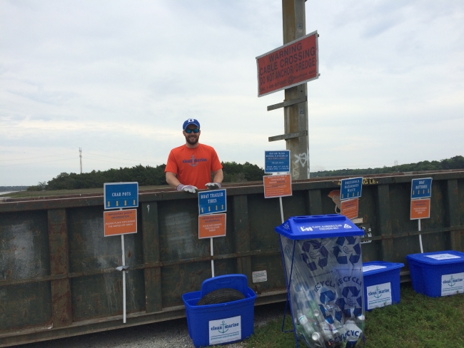 A Clean Marine volunteer helps collect items for disposal or recycling from the Limehouse Bridge Boat Landing near Charleston, SC.