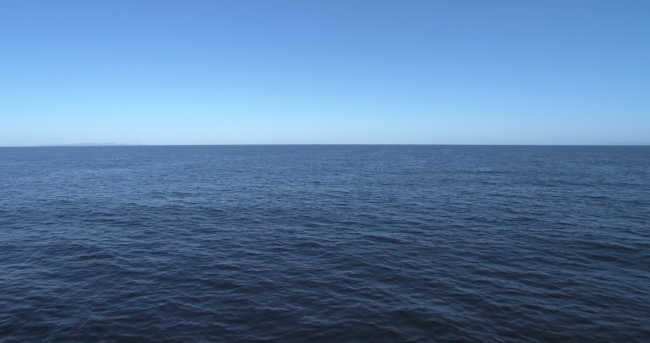 An image of the open ocean with only water and sky visible.