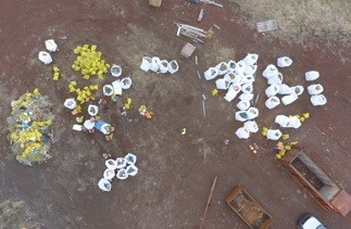 An aerial view of debris sorted into piles.