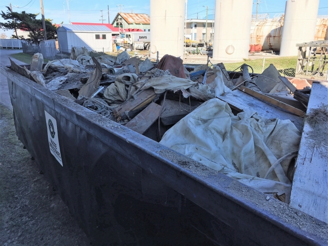 Debris that was removed from Beaufort's waterway sits in a dumpster.