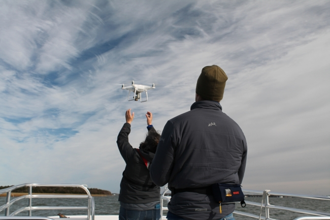 TowBoatUS Foundation and Paul Cronin studios retrieve an unmanned aerial vehicle during filming of the marine debris project documentary.
