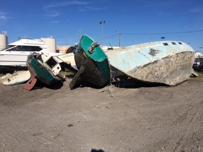 Abandoned vessels removed from Beaufort's waterway sit on land.