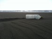 Plastic bottle on a beach.