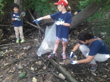 Kids cleaning up a shoreline.