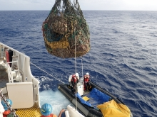 Large net being pulled onto a boat.