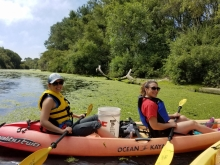 Volunteers in a kayak on Pajaro River.