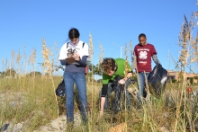 Students collecting data during the Mississippi Coastal Cleanup.