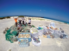 The Marine Debris team (of six) stand tall among 12,030 lbs. of derelict fishing nets and 8,000 lbs. of plastics removed from the shorelines of Midway Atoll National Wildlife Refuge.