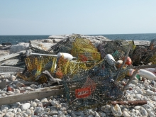 A pile of fishing gear laying on the beach.