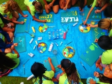 Students create signs to discourage littering and encourage recycling. (Photo Credit: Hawai'i Wildlife Fund)