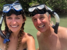 Daughter and father enjoy snorkeling in South Florida.