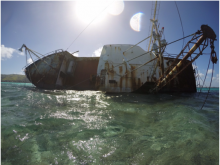 An abandoned ship has been tipped on its side.