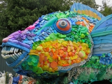 A sculpture of a parrotfish made of marine debris.