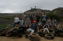 People sitting on a pile of tires.