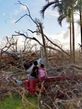 Two sisters observe the aftermath of Typhoon Yutu in the Mariana Islands (Photo: Micronesia Islands Nature Alliance).
