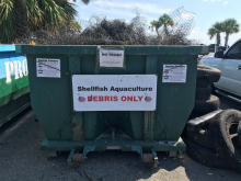 Dumpster for aquaculture debris.