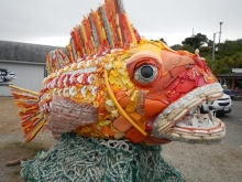 A large fish sculpture created with marine debris.
