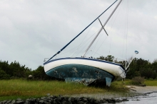 A sailboat lays on its side in the Rachel Carson Reserve.