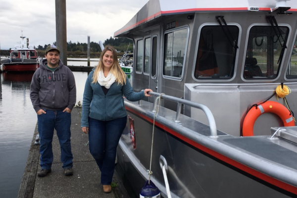 Makah Tribe project managers pose with the Tribal Enforcement Vessel.