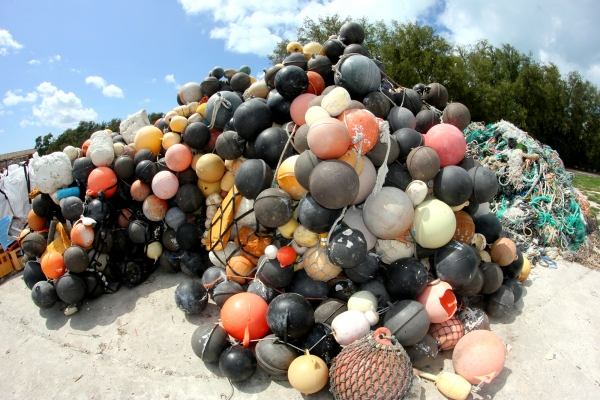 A large pile of hard plastic buoys (4,178) and foam buoys (1,467).
