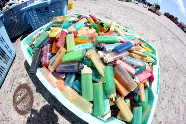 A bucket of lighters.