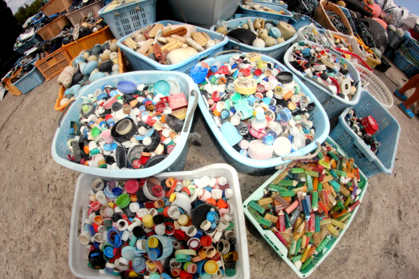 Buckets of bottle caps and lighters.